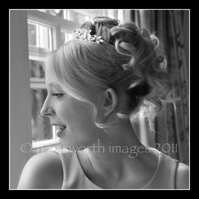 Bride with hair up and tousled, relaxed wedding curls