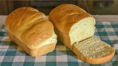 Easy butter bread on a blue plaid cloth.