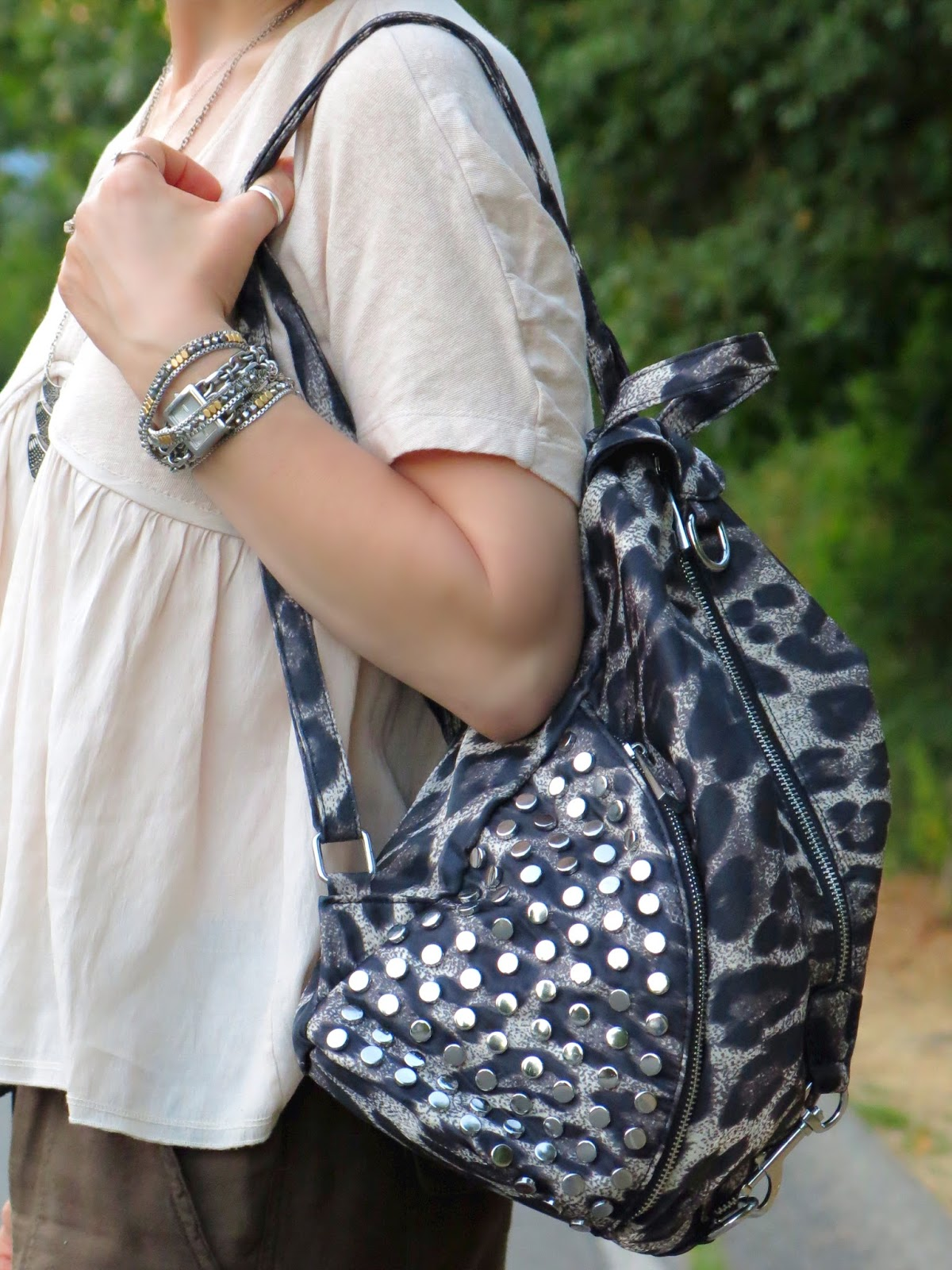 Zara top, leopard backpack, and accessories