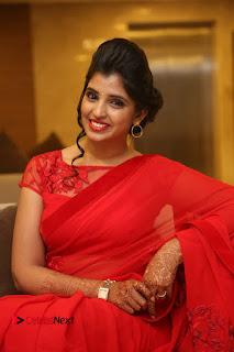 Actress Shyamala Stills in Red Saree at Okkadochadu Movie Audio Launch  0439