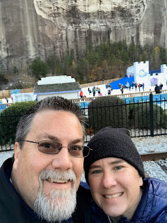 A photo of David Brodosi and his wife enjoying the first snow of the year