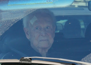 Picture of Bob Barker sitting in a car