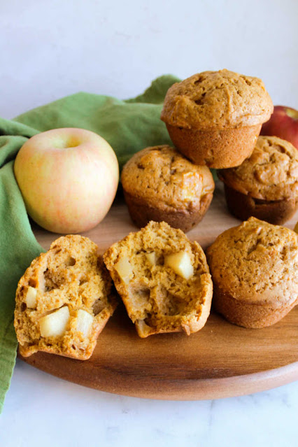 half a pumpkin apple muffin with soft interior showing