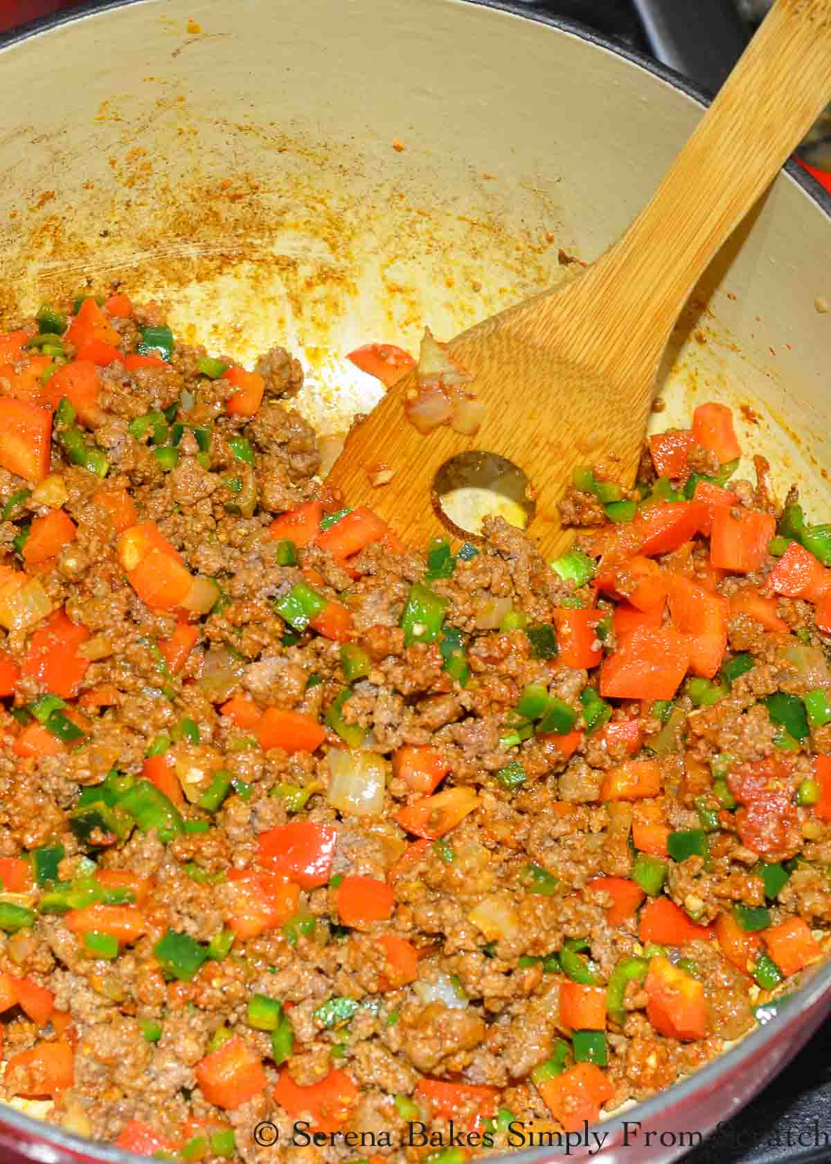 Cooked Ground Beef and Peppers in a large pot.