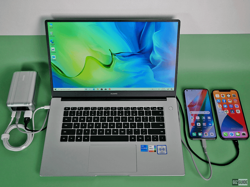 While charging a laptop and two smartphones