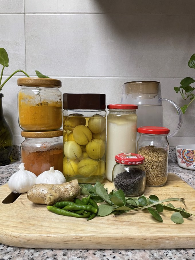 Lime pickle ingredients laid out