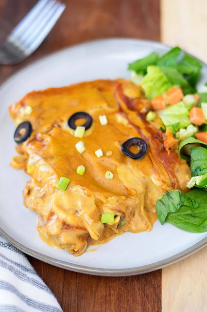A piece of the vegan chicken-less tamale casserole with a salad on the side.