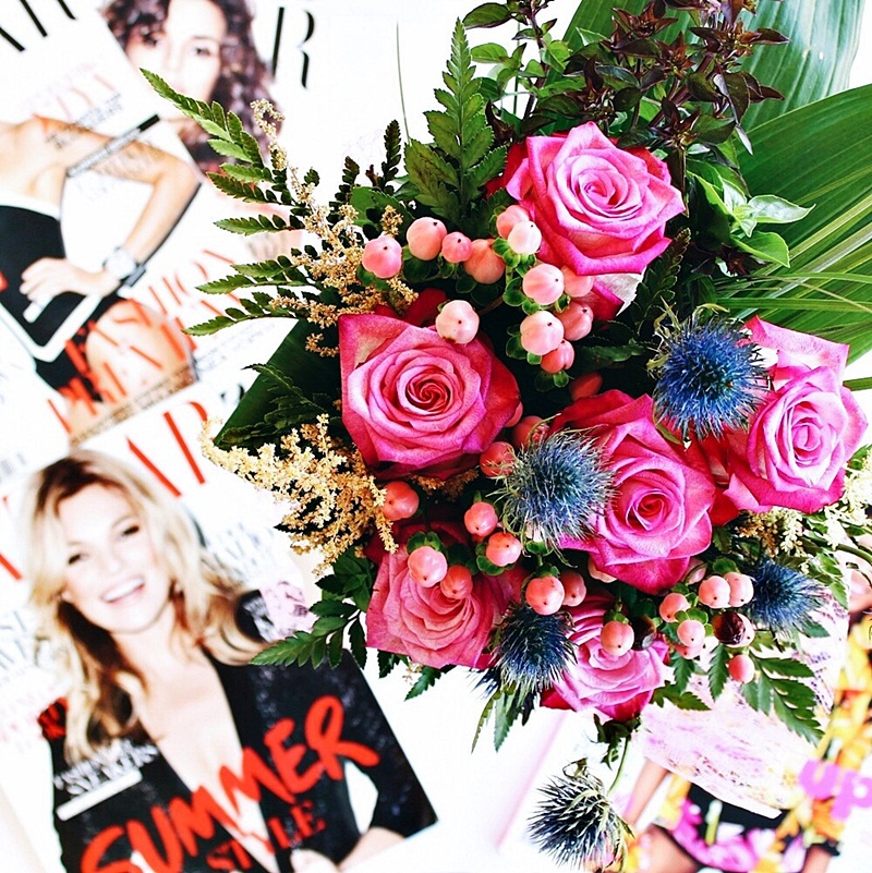 pretty flower bouquet flatlay styling with pink roses