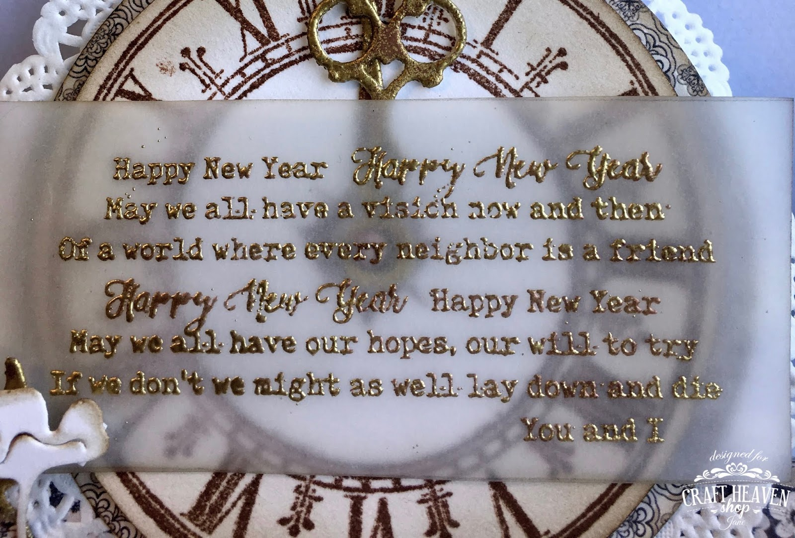 i have used the happy new year text stamp i have stamped it onto vellum and embossed it with a mixture of copper and gold embossing powders