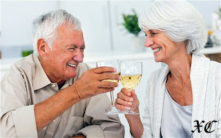 Old couple drinking alcohol