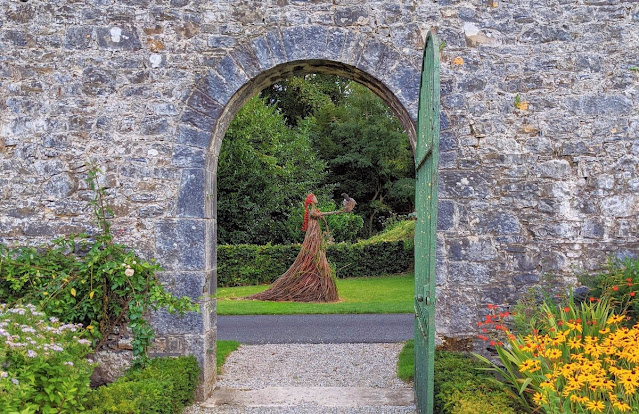 Dingle to Dublin Drive: stick sculpture of a woman at Adare Manor