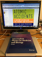 Reading Atomic Accidents,  by Jim Mahaffey,  in my home office, with Intermediate Physics for Medicine and Biology nearby.
