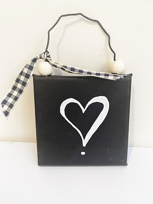 black canvas with a heart