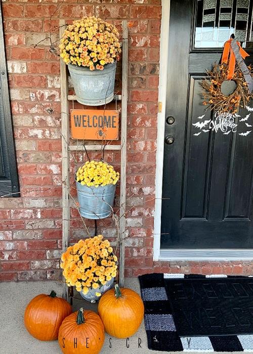 Halloween Porch - mums in buckets on vintage ladder