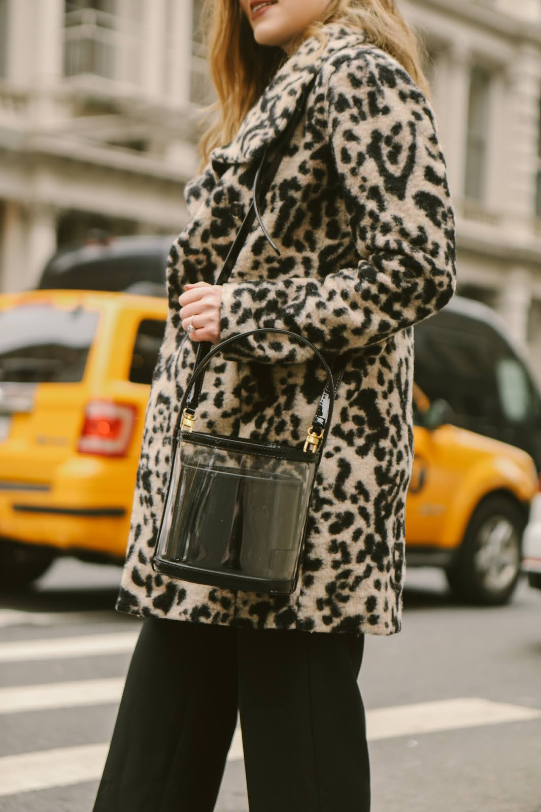 Nyc fashion blogger Kathleen Harper wearing a black and clear Stuad bucket bag.