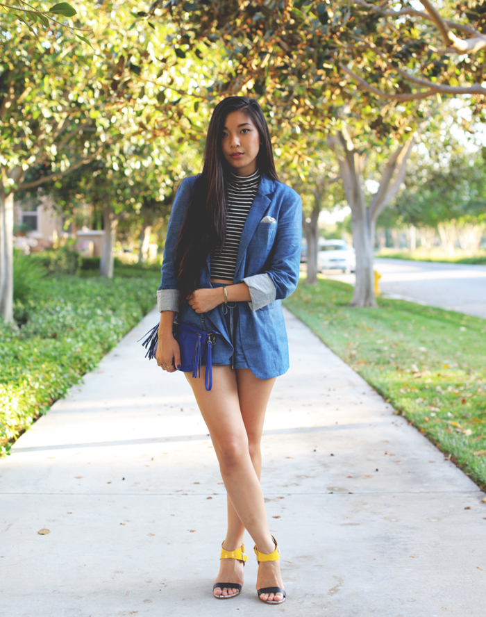 Stephanie Liu of Honey & Silk wearing Greylin chambray short suit, American Apparel crop top, Kelsi Dagger Carmanita heels, Urban Outfitters crossbody, and Chloe & Isabel earrings.