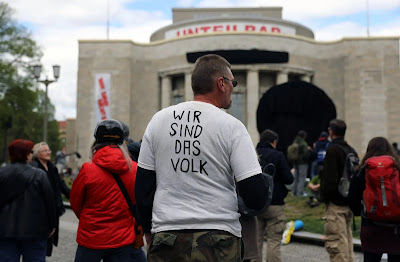 A protester in front of the Volksbühne.   Image: Reuters / Christian Mang