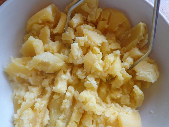 Mash the drained potatoes with the butter and milk