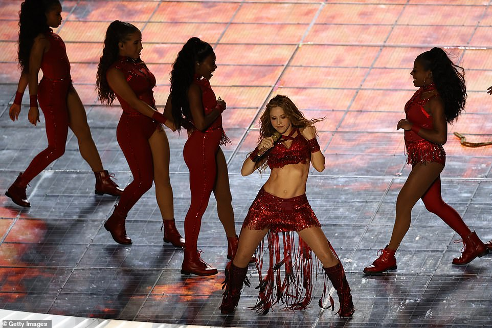 Shakira's dancers donned red outfits that coordinated with the star's glittering ensemble