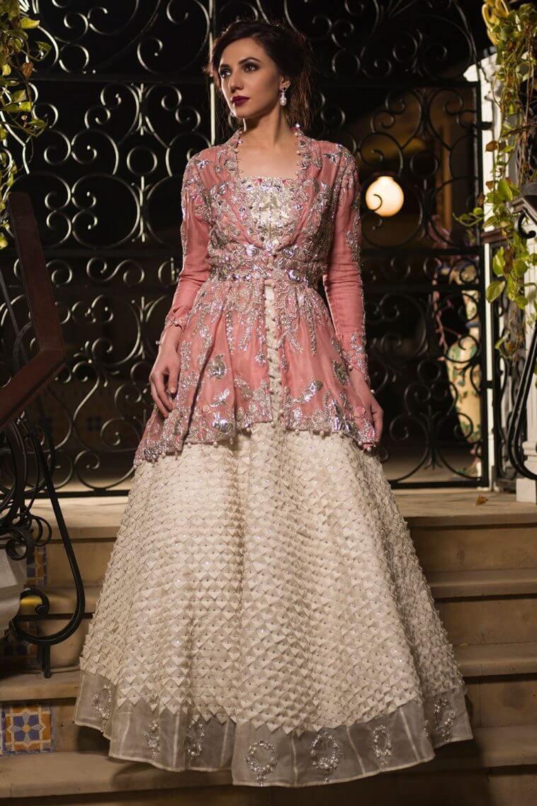 Pink peplum cut Pakistani bridal outfit by Nida Azwer Pakistani bridal outfits
