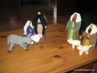 donkey, Mary, Joseph, baby, manger, two shepherds and lambs, all knitted