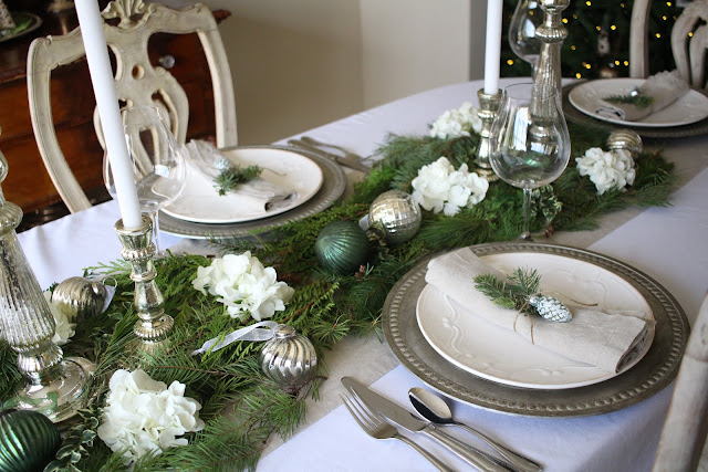 holiday tablescape with natural elements neutrals greens and silvers christmas