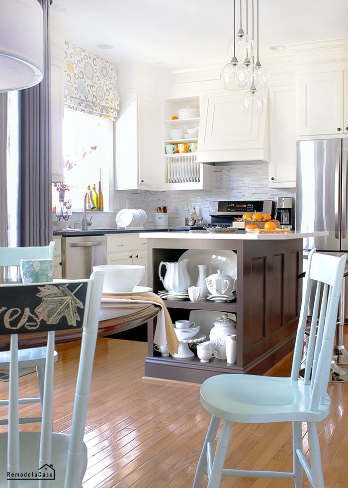 kitchen makeover with painted cabinets, marble backsplash and many more