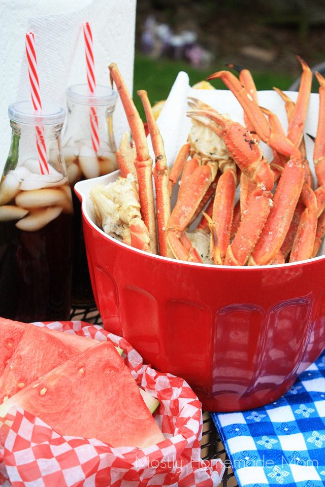 Grilled Crab legs picnic table spread with sodas and sliced watermelon for summer