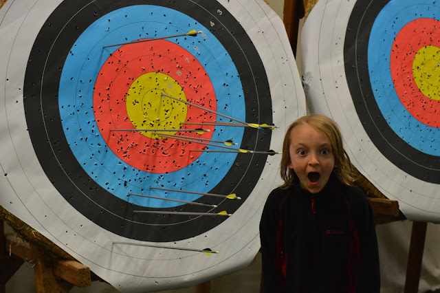 George standing by his archery achievement!