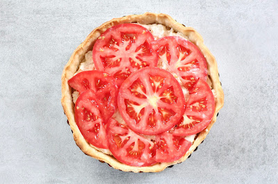 Pie crust filled with tomato and mayonnaise spread