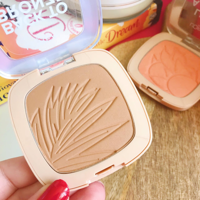 L'oreal Back To Bronze Bronzer held up, L'oreal Life's A Peach Blush next to it