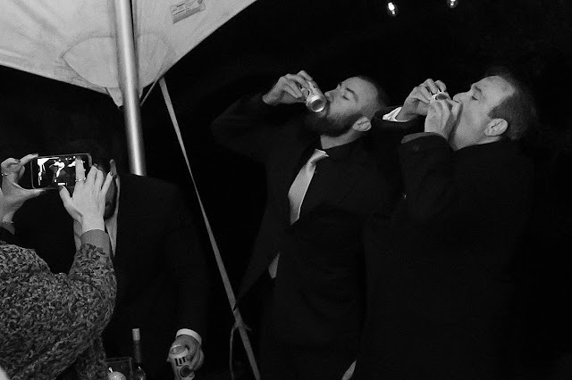 Groom and Groomsman wolfbiting some bud lights Magnolia Farm Asheville Wedding Photography captured by Houghton Photography