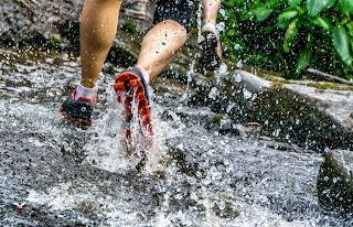 Feet running through water