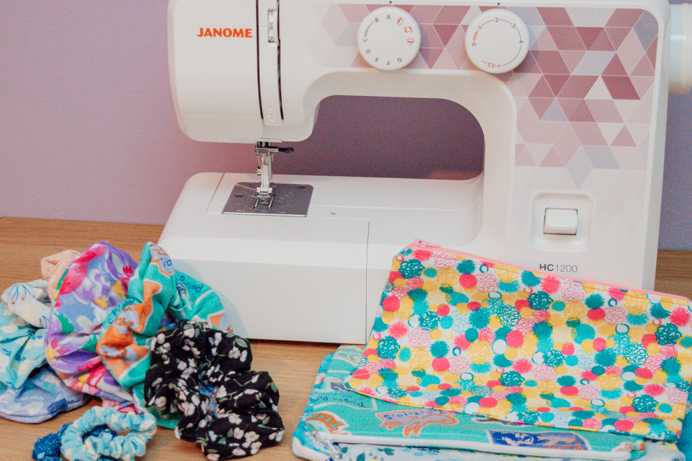 Sewing machine behind scrunchies and pouches