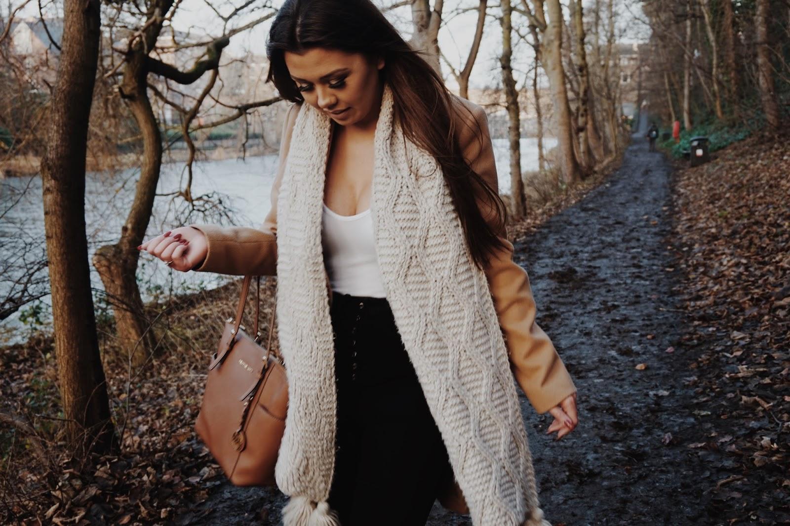 Beige coat and cream scarf