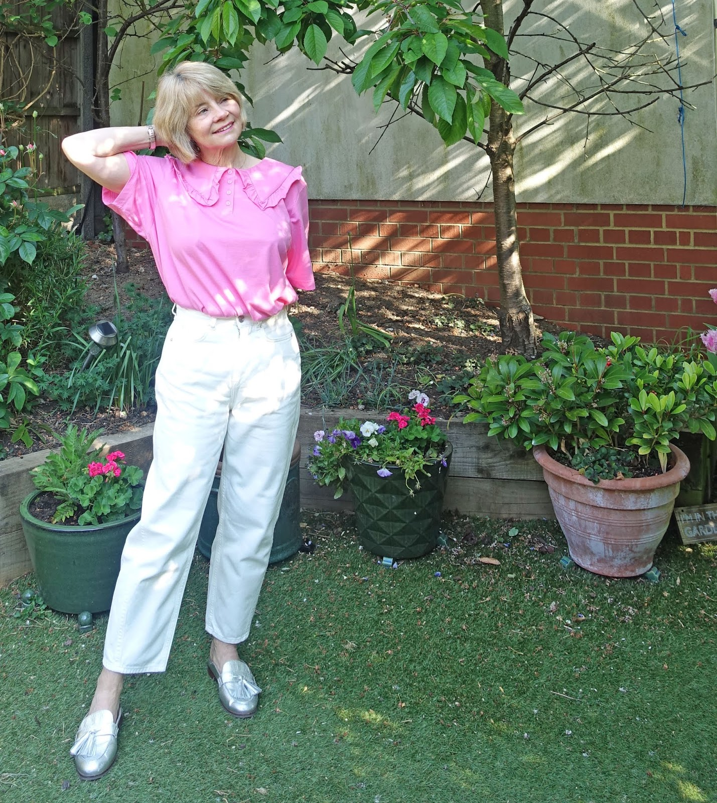 Pink top with statement collar and white jeans worn by over 50s blogger Gail Hanlon from Is This Mutton?