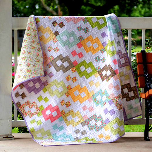 Shortcut Layer Cake Quilt designed By Kimberly of Fat Quarter Shop, features the Finnegan fabric collection by Brenda Riddle for Moda Fabrics