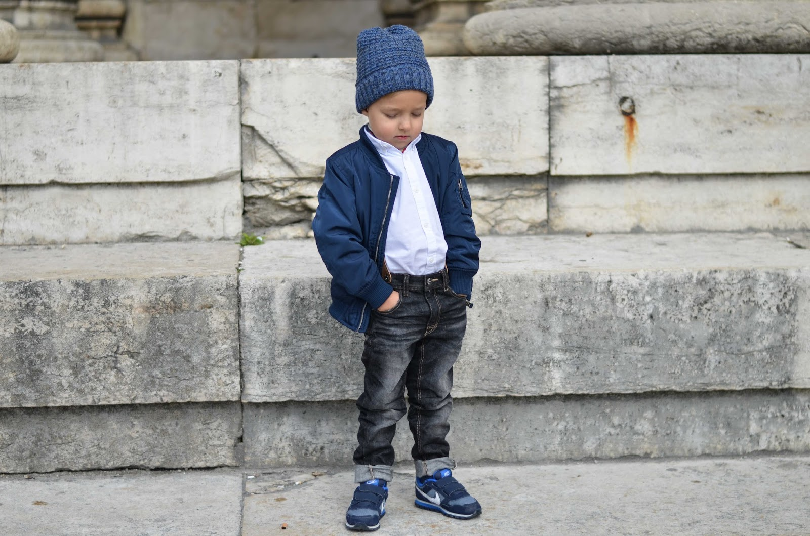 toddler boy style fall outfit bomber jacket jeans beanie white shirt