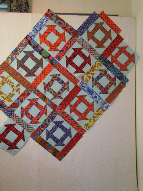 Churn Dash quilt block with Brandon Mabley fabric