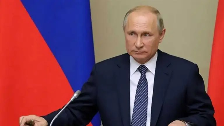 Russian President Vladimir Putin signs a law allowing him to run for two new terms