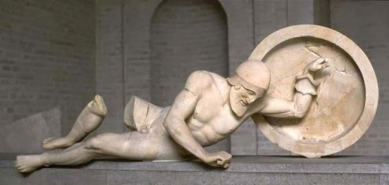 The Dying Warrior, located at the pediment of the temple of Aphaia at Aegina. Glyptothek, Munich Berlin