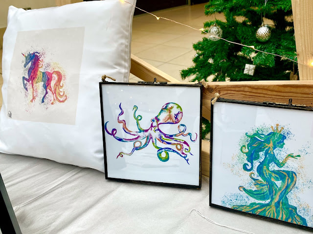 A unicorn print on a cushion and an octopus and a mermaid framed prints by Burellio
