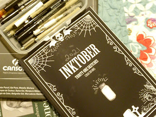 Image of Inktober sketchbook with collection of pens and paper