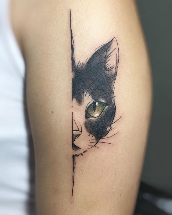 Cat Eye Tattoo on arm