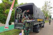 Dengan Menaiki Truk Dinas Militer, Satgas TMMD Reg 109 Kembali Ke Home Base