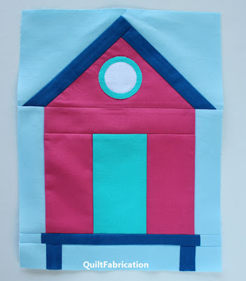 pink beach house with blue trim