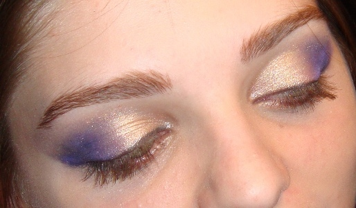 brows with purple and gold eye shadow