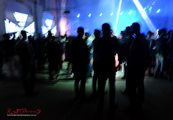 Room and light show filled with people. UE Boom 2 Launch at Carriageworks Sydney #PartyUp photographed by Kent Johnson for Street Fashion Sydney.