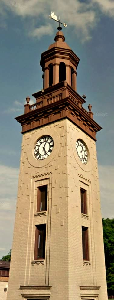 299 N. 5th St., Columbia PA, beige stone clock tower with brown accents and wind vane cupola