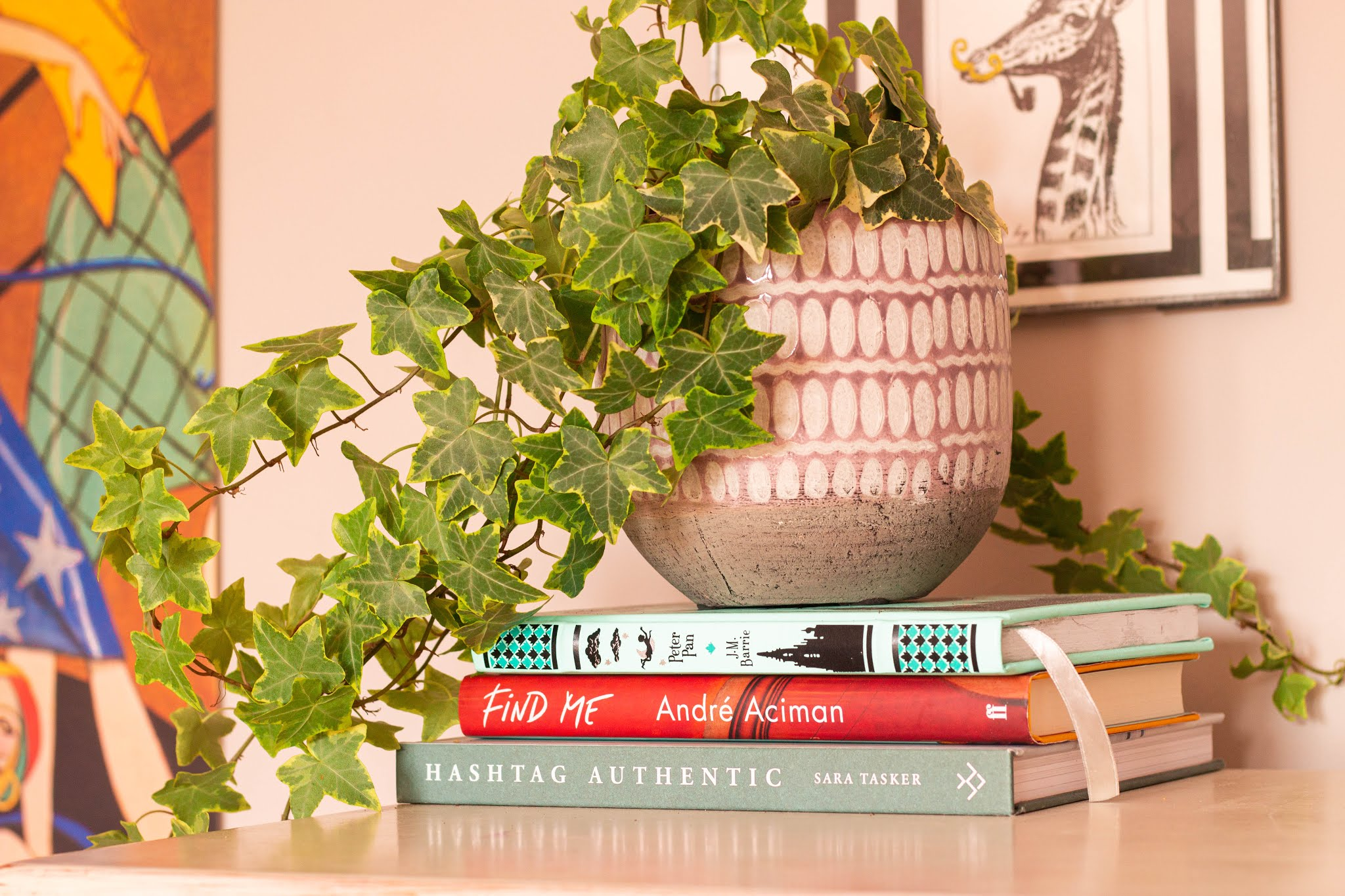 Bedroom details, plant, and books. Interior design and styling tips, 25% off Photowall Sweden Discount code